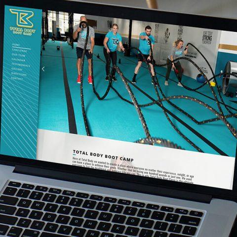 Azula Web Total Body Boot Camp Lansing Gym website on laptop.